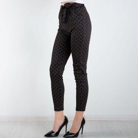 Czarne legginsy z printem - Odzież