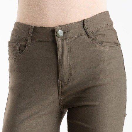 Damskie spodnie jeansowe w kolorze zielonym - Spodnie