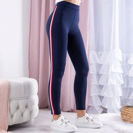 Granatowe legginsy w kolorowe paski - Spodnie