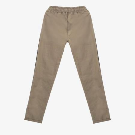 Zielone spodnie dresowe z lampasami - Odzież