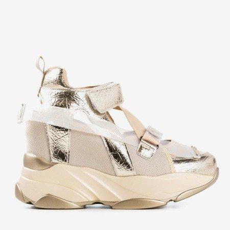 Złote sneakersy sportowe na krytym koturnie z wycięciami Karix - Obuwie